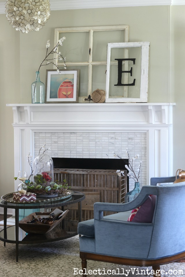 Spring mantel - love the old windows and the chicken coop fireplace cover kellyelko.com