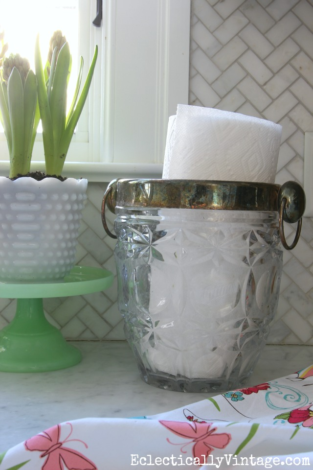 Great idea for a paper towel holder - a vintage ice bucket! Love these quick and easy kitchen decorating ideas kellyelko.com