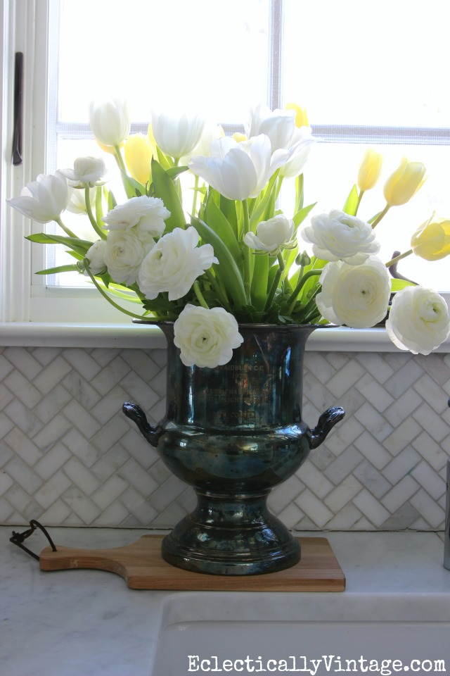 Love this monochromatic flower arrangement in an old silver champagne bucket kellyelko.com