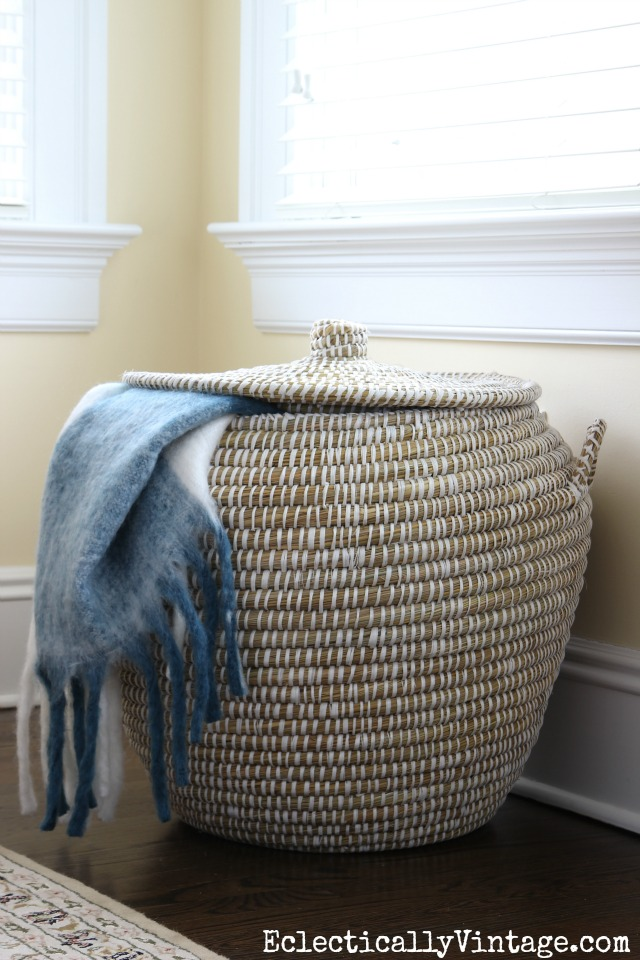 Woven basket with lid is perfect storage for extra throws and pillows kellyelko.com