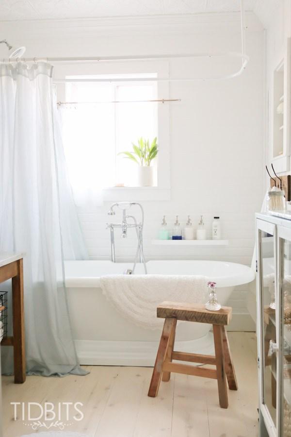 Cottage bathroom - love the freestanding bathtub and rustic wood stool kellyelko.com