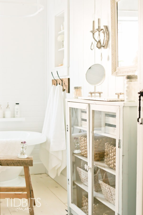 Use a piece of furniture in the bathroom for storage and farmhouse appeal kellyelko.com