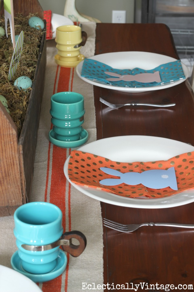 Easter table - love the colorful vintage mugs and napkins kellyelko.com