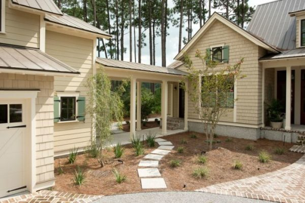 Coastal home exterior - love the covered walkway connecting the house to the garage kellyelko.com