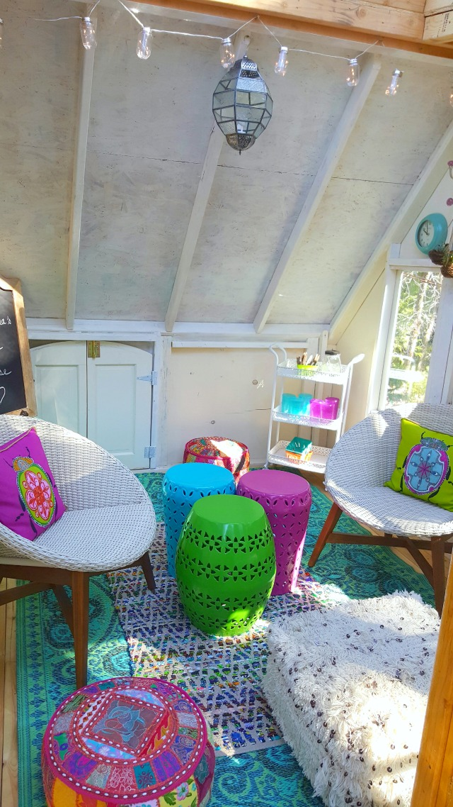 Love this colorful furniture in this rustic treehouse kellyelko.com