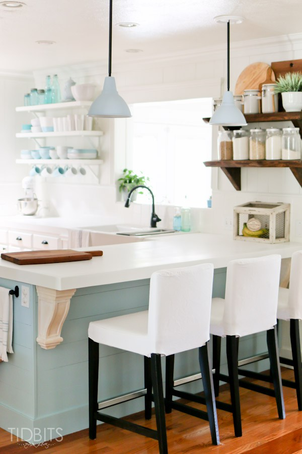 Cottage kitchen with lots of character from rustic wood shelves and planked walls kellyelko.com