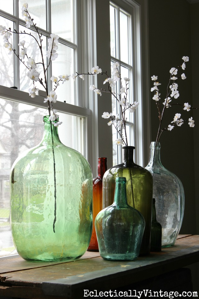 Demijohn collection with spring flowers kellyelko.com