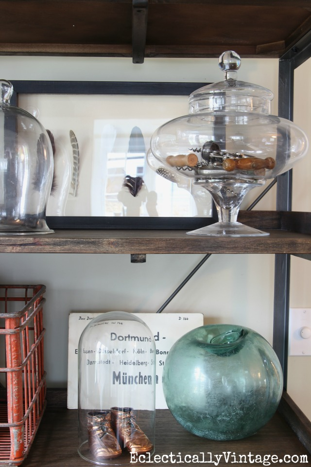 Eclectic shelf display - love the collection of corkscrews in the glass jar kellyelko.com