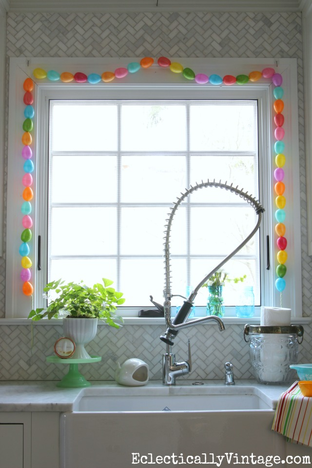 Spring Home Decorating Tour - tons of great ideas to freshen up your home like the colorful DIY egg garland kellyelko.com