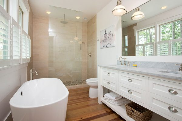 Love this white master bathroom with double marble vanity and freestanding tub kellyelko.com