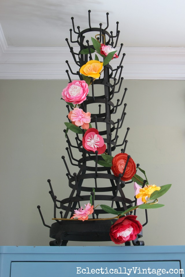 Love this huge bottle drying rack with the flower garland for spring kellyelko.com
