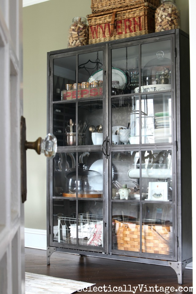 Love this glass front industrial cabinet - perfect for storage in the dining room kellyelko.com