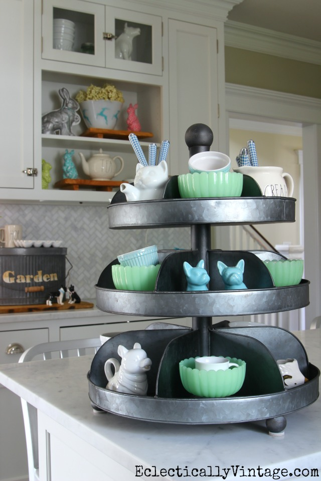 I love tiered trays for displaying favorite things on the kitchen counter like this mix of jadeite and white bowls kellyelko.com #spring #springdecor #springdecorating #springcrafts #hometour #housetour #eclectichome #farmhousedecor #fixerupperstyle #jadeite #farmhousestyle #vintagedecor #vintagehome #kellyelko #industrialdecor #whitekitchen #kitchendecor