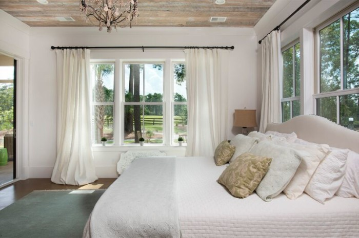 Love the reclaimed barn wood ceiling in this coastal master bedroom kellyelko.com
