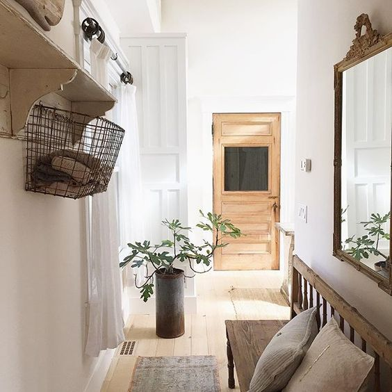 Beautiful hallway - love the wood bench and that glass door! kellyelko.com