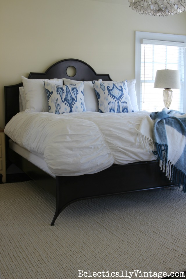 Love this neutral textured rug in this master bedroom - it is the perfect complement to the black metal bed kellyelko.com
