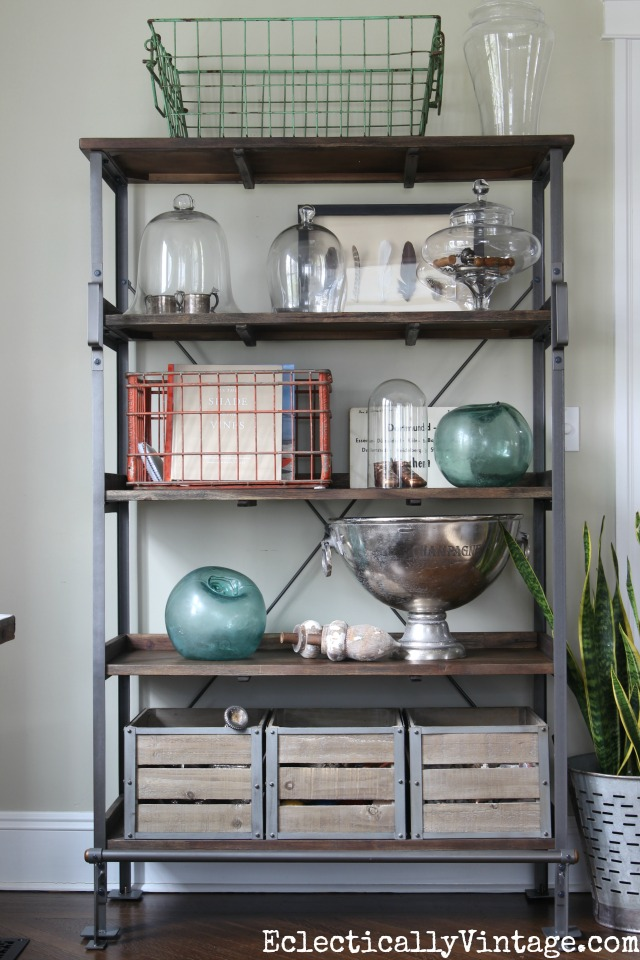 Open industrial shelf display - love the wire baskets and glass cloches kellyelko.com