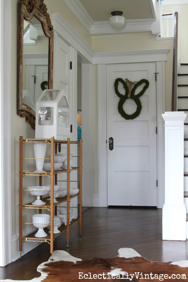 Fresh spring foyer with a beautiful collection of milk glass and a cute bunny wreath kellyelko.com