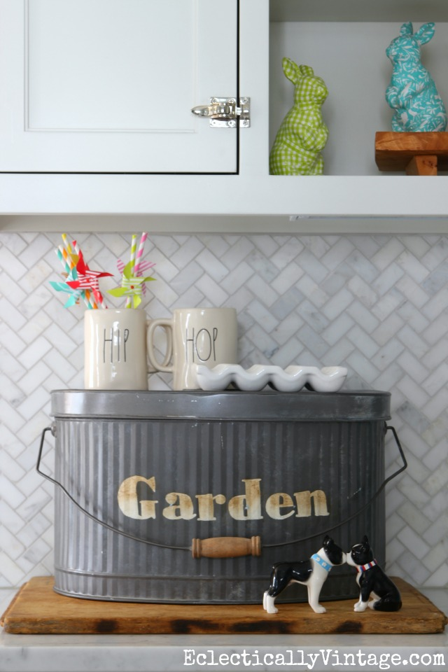 Love this galvanized garden pail on the kitchen counter for storing clutter kellyelko.com