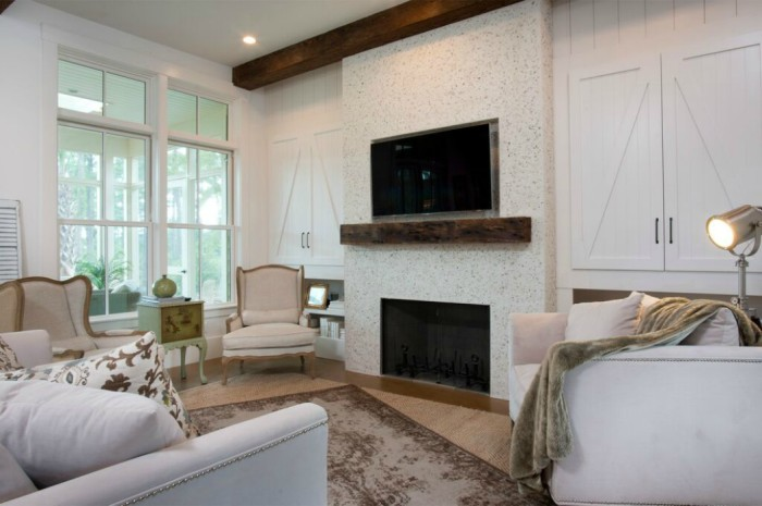 Tabby shell mantel makes a stunning focal point in this coastal home kellyelko.com