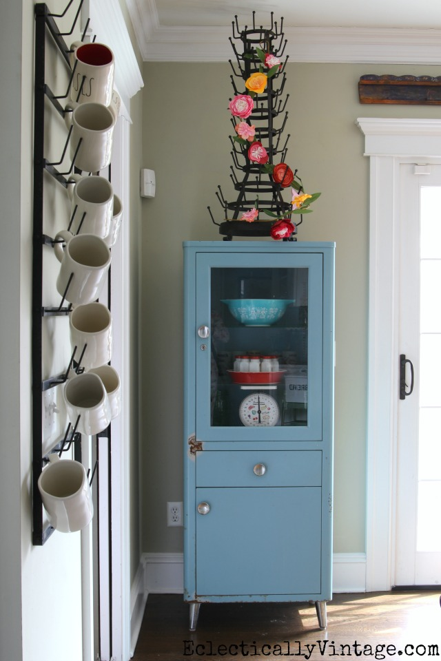 Vintage blue medical cabinet looks great in a kitchen kellyelko.com