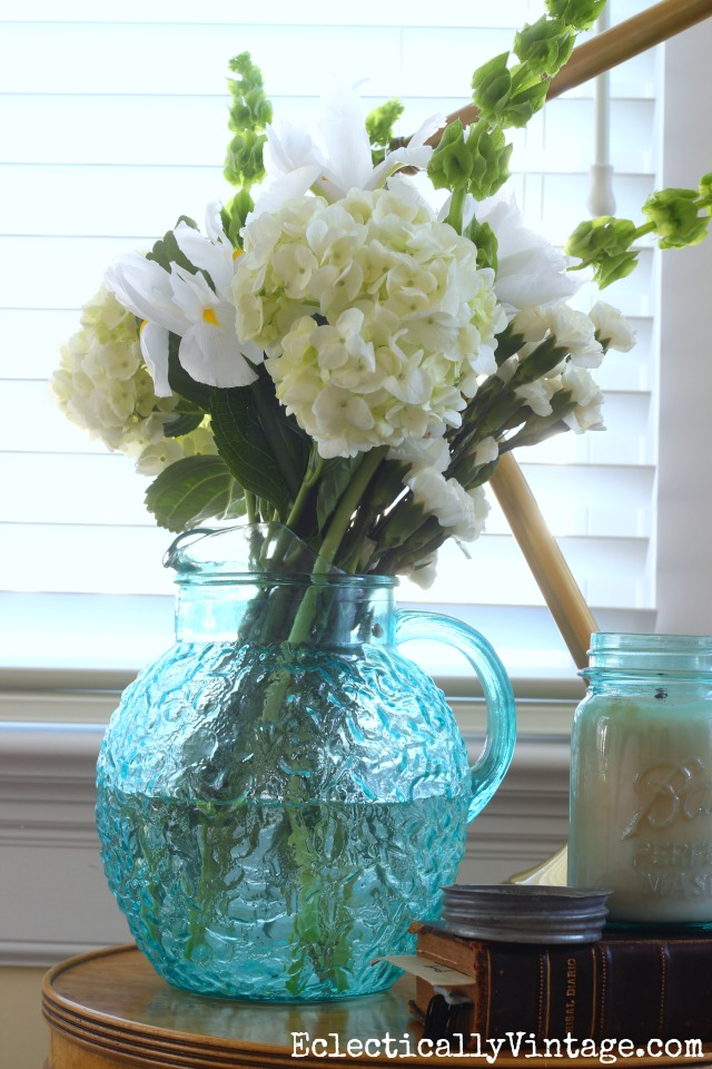 Gorgeous white flower arrangement in a vintage blue pitcher kellyelko.com