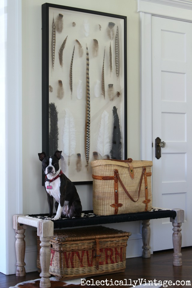 Love this woven black and white Chindi bench combined with the feather art in this foyer kellyelko.com