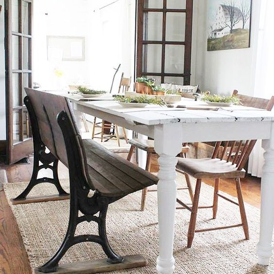 An antique bench is a fun addition to this farmhouse dining room kellyelko.com
