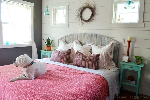 Love this cozy cottage bedroom with rustic barn wood headboard and planked walls kellyelko.com