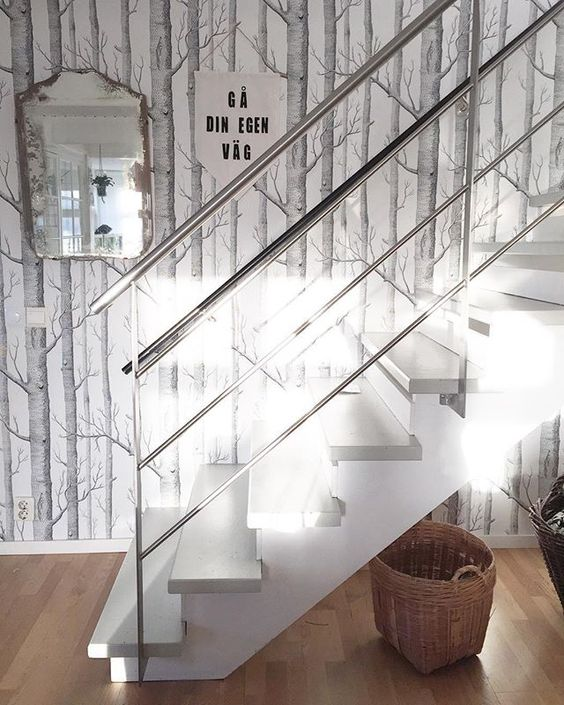 Love the birch tree wallpaper on this staircase kellyelko.com