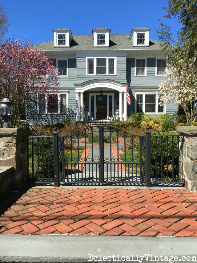 Curb Appeal - love this black iron gate and the charming path kellyelko.com