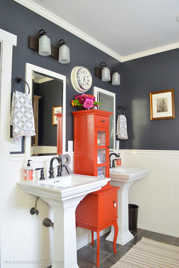 Colorful master bathroom - love the dark paint paired with lots of white and a fun pop of color with the red cabinet kellyelko.com