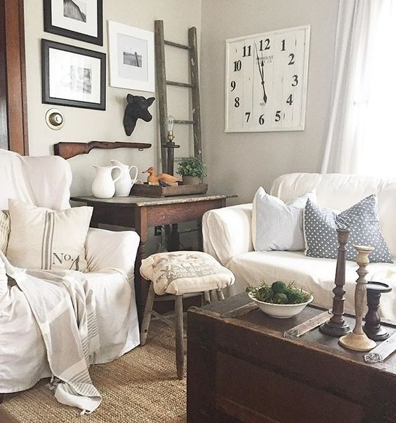 Cozy family room - love the white slipcovered furniture and the rustic trunk coffee table kellyelko.com