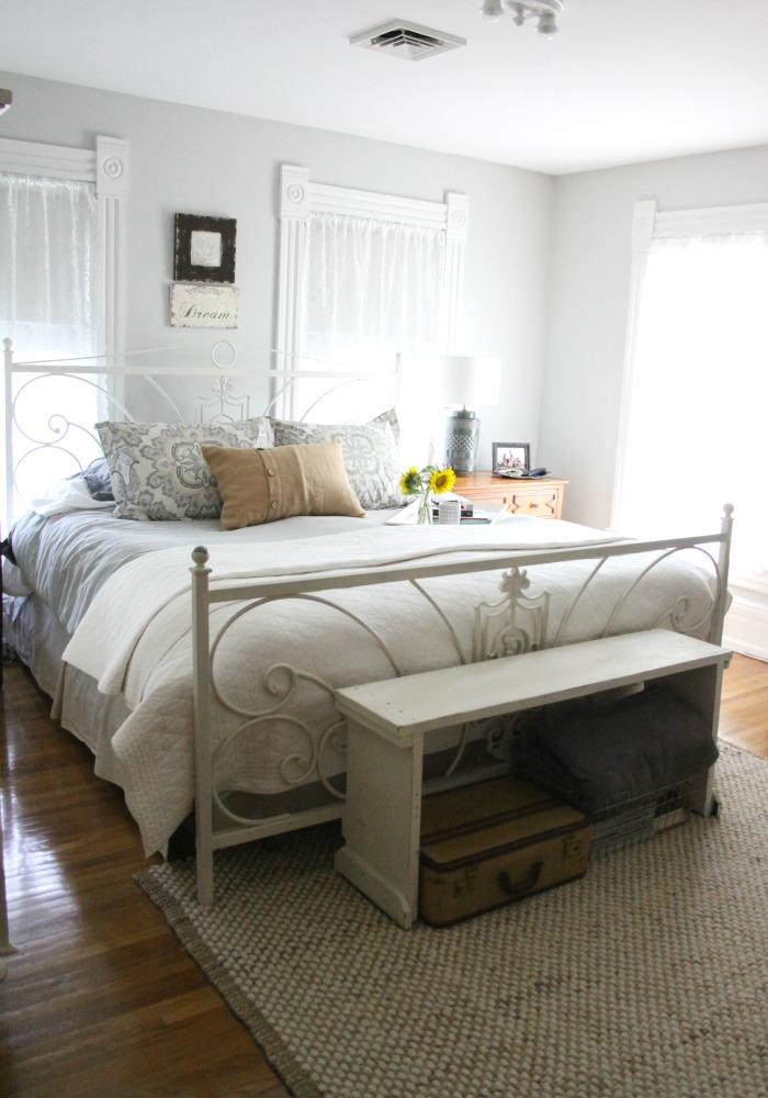 Cozy gray bedroom - love the rustic bench at the foot of the bed kellyelko.com