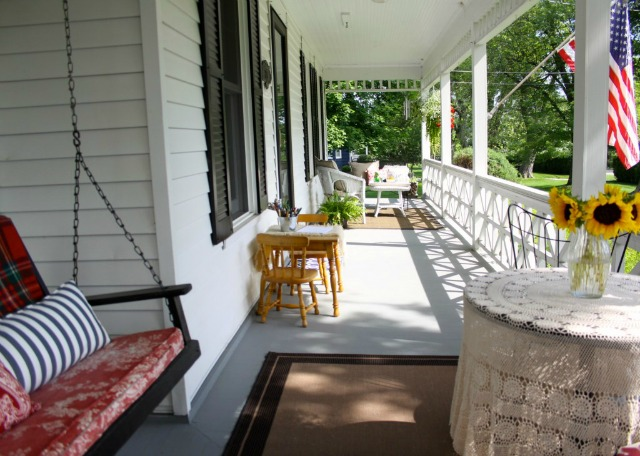 Farmhouse front porch swing eclecticallyvintage.com