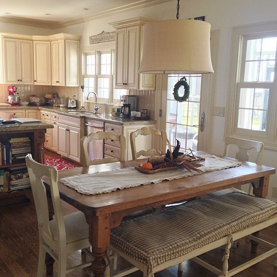 Farmhouse kitchen table and mismatched chairs with bench kellyelko.com