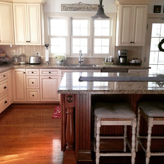 Farmhouse kitchen - love the white cabinets and natural wood island kellyelko.com