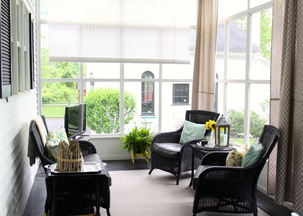 Farmhouse porch - love the black wicker furniture eclecticallyvintage.com