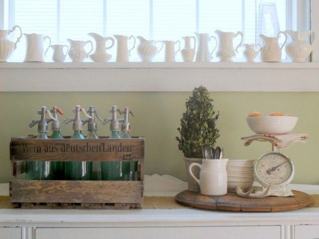 Love this ironstone pitcher collection lined up on a windowsill! kellyelko.com