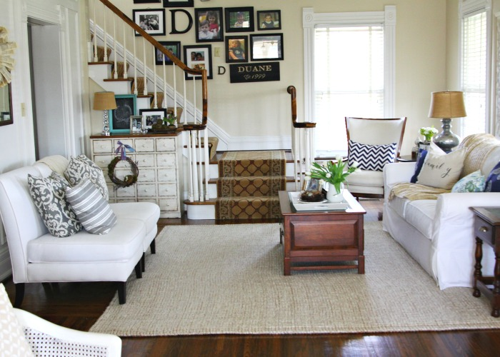 Love this neutral living room and the staircase gallery wall eclecticallyvintage.com