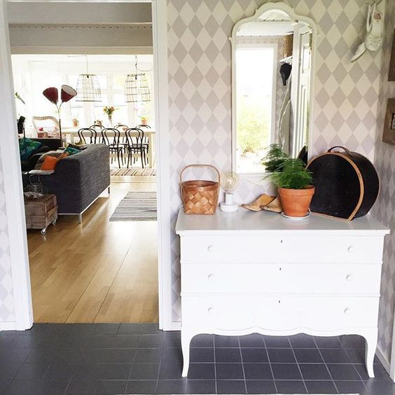 Love the painted harlequin wall in this foyer kellyelko.com