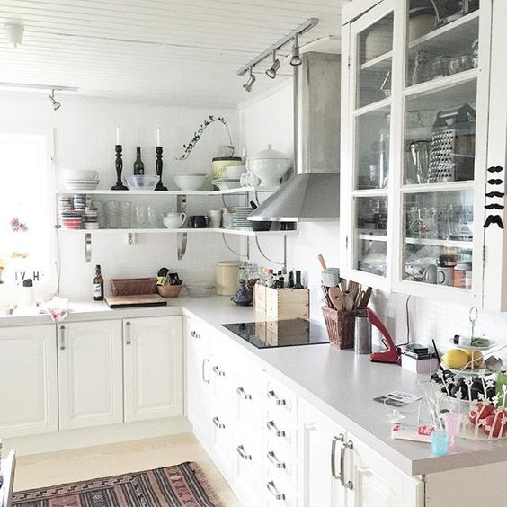 Love the open shelving combined with glass front cabinets in this functional kitchen kellyelko.com