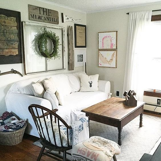 Love this neutral family room with slipcovered sofa and eclectic gallery wall kellyelko.com