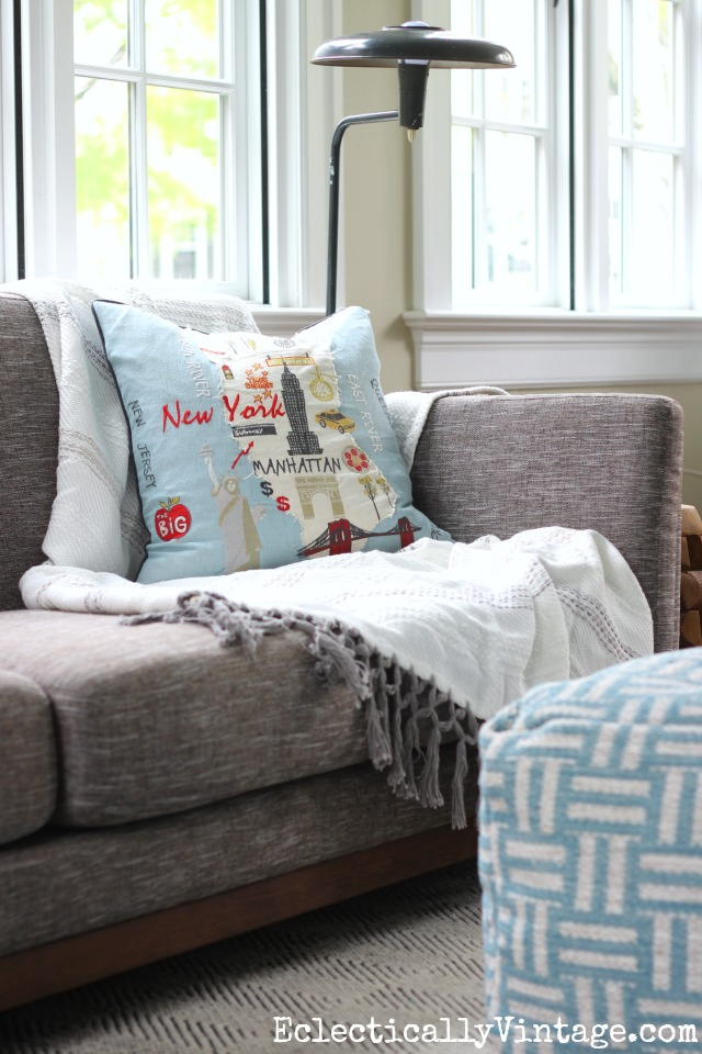 Love this cozy sofa, throw, pillow and pouf kellyelko.com