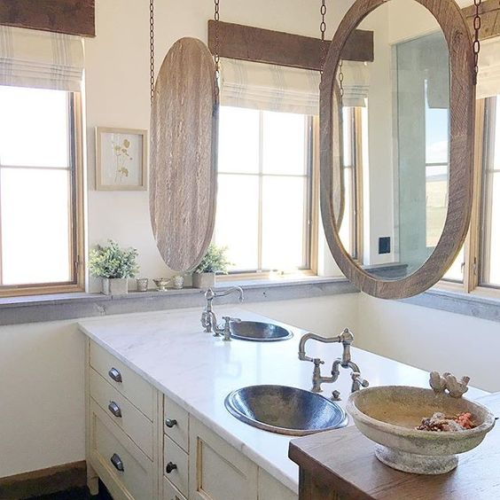 Great idea to hang bathroom mirrors from the ceiling when short on wall space kellyelko.com