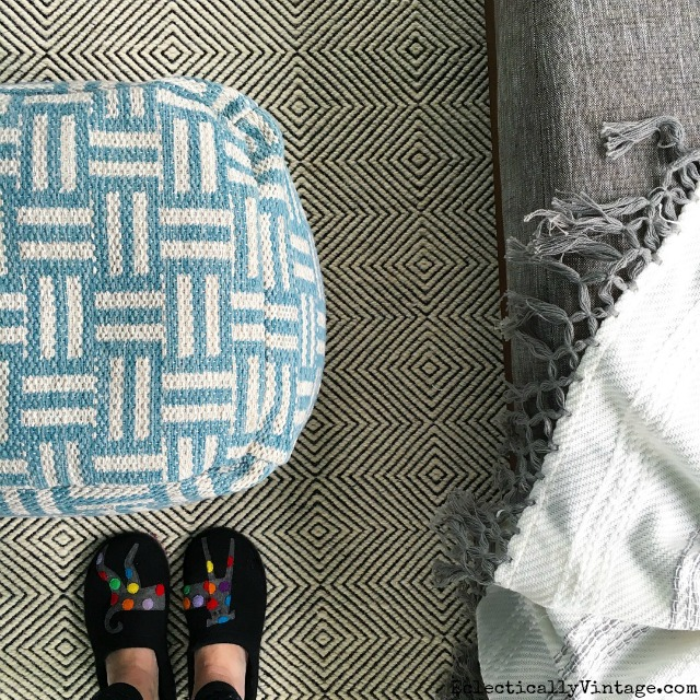 Love the pattern mix in this graphic rug and pouf kellyelko.com