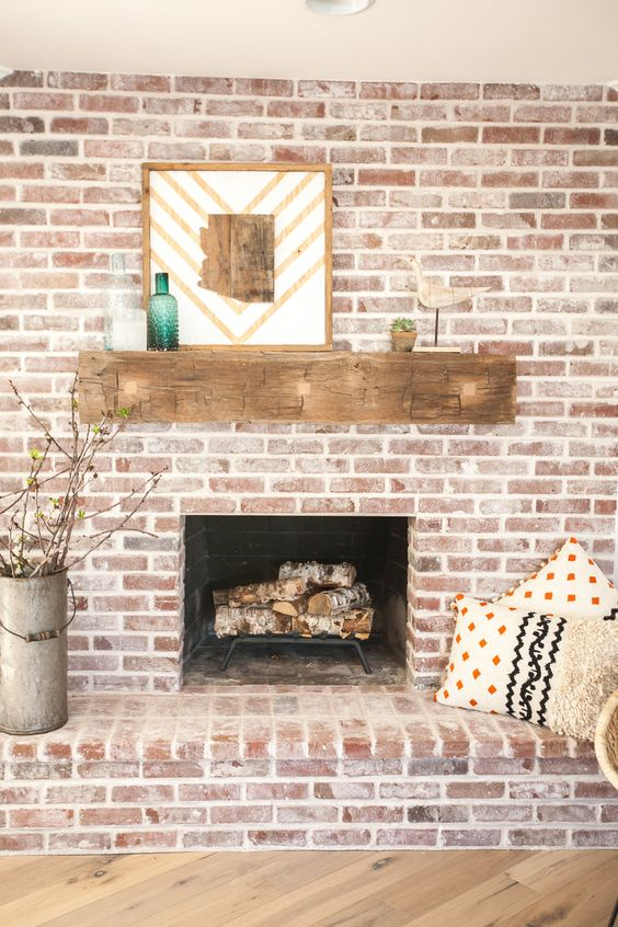 Brick fireplace with antique beam mantel kellyelko.com