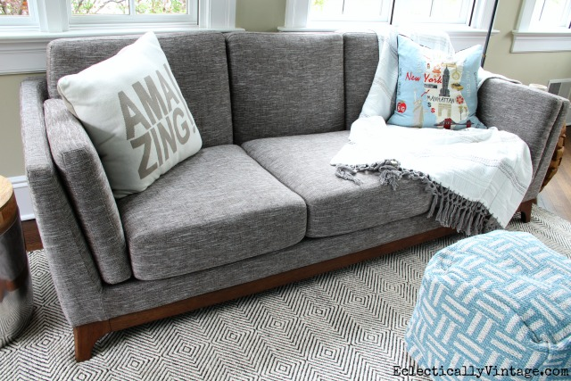 Love this modern gray sofa and rug kellyelko.com