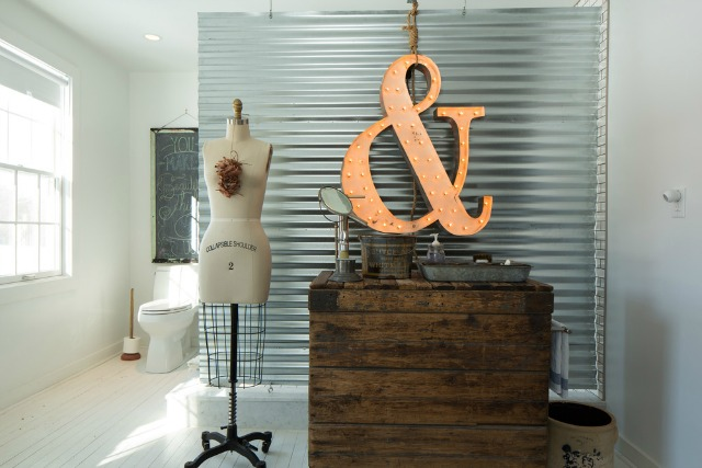 Corrugated metal makes a perfect privacy screen in this farmhouse bathroom kellyelko.com