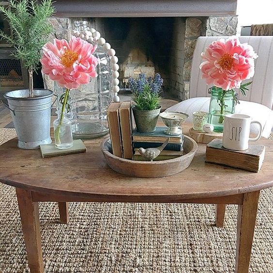 Farmhouse coffee table - love the pink peonies kellyelko.com